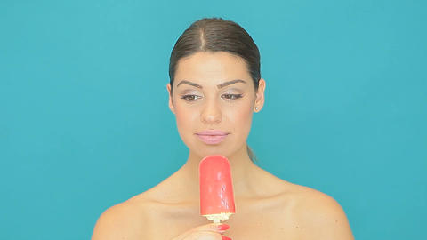 Beautiful woman eating an icecream sucker Stock Video Footage