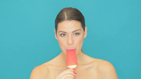 Beautiful woman eating an icecream sucker Stock Video Footage