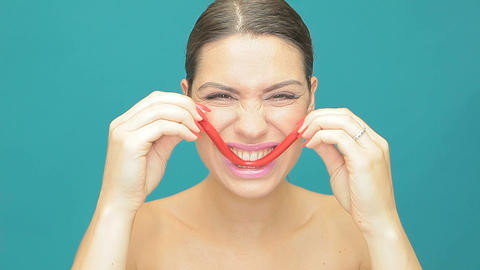 Playful woman with red jelly smile Stock Video Footage