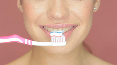Smiling woman with toothbrush Stock Video Footage