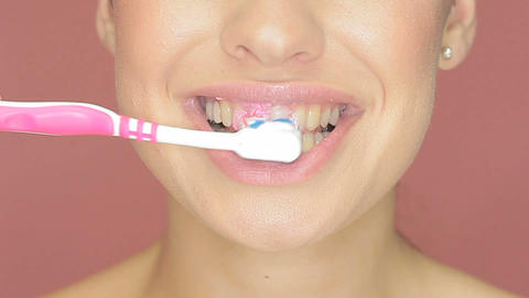 Smiling woman with toothbrush Footage