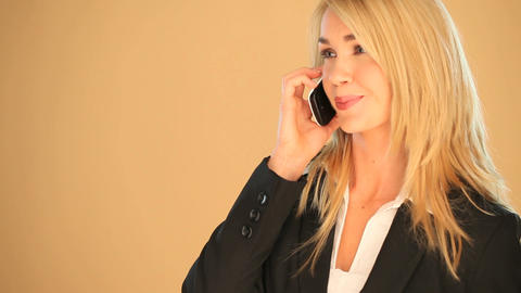 Blonde businesswoman on a smartphone Footage