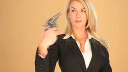 Blonde businesswoman with a gun Stock Video Footage