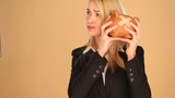 Blonde Businesswoman With A Piggybank stock footage