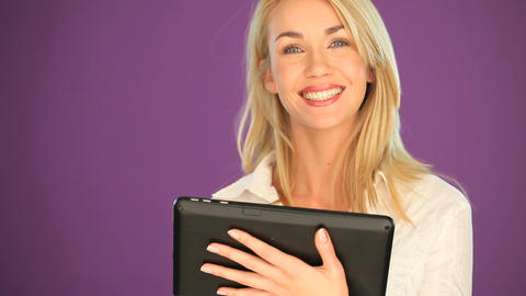 Happy blonde student working on a tablet Footage