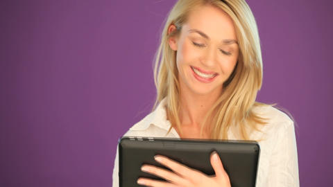 Happy blonde student working on a tablet Stock Video Footage