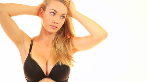 Busty blonde woman in a bra Stock Video Footage
