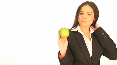 Businesswoman holding a fresh apple Stock Video Footage