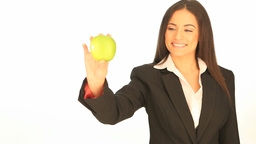 Businesswoman holding a fresh apple Footage