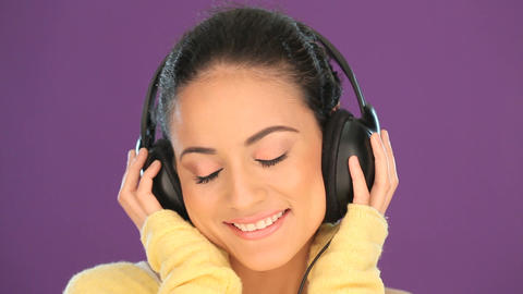Beautiful woman listening to music Footage