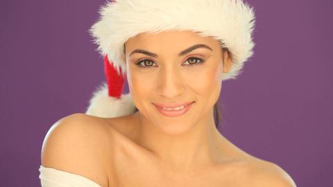 Beautiful woman wearing a Santa hat Stock Video Footage