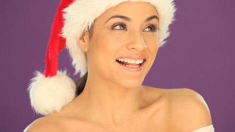 Beautiful woman wearing a Santa hat Footage