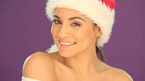 Beautiful woman wearing a Santa hat Stock Video Footage