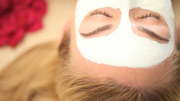 Face mask on blonde woman Stock Video Footage