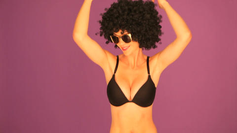 Woman with afro dancing in black underwear Stock Video Footage