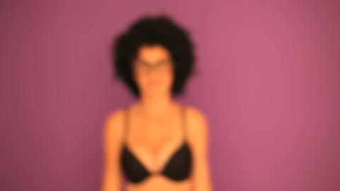 Woman with afro stepping into focus Stock Video Footage