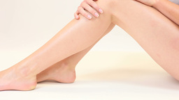 Blonde woman stroking smooth legs Stock Video Footage