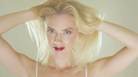 Pretty blonde woman playing with her hair Stock Video Footage