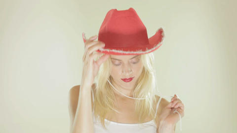 Pretty blonde in a red cowgirl hat Stock Video Footage