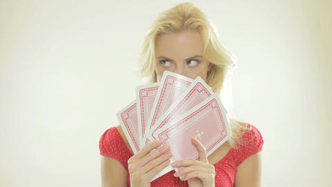 Blonde woman holding playing cards Stock Video Footage
