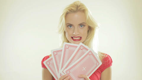Blonde woman holding playing cards Footage
