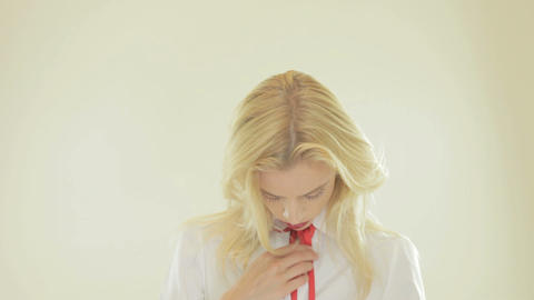Pretty blonde woman removing her tie Stock Video Footage