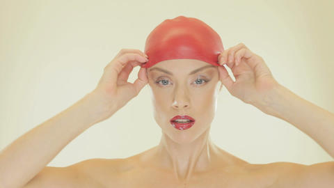 Attractive woman removing her bathing cap Stock Video Footage