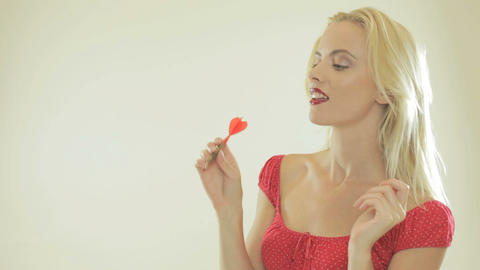 Beautiful woman playing darts Stock Video Footage
