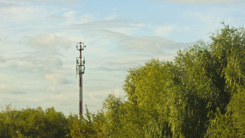 clouds over antenna and trees Stock Video Footage