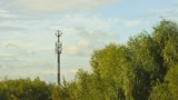 clouds over antenna and trees Footage