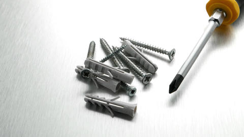 Screwdriver, Screws And Plastic Dowels stock footage