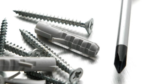 Screwdriver, screws and plastic dowels Footage