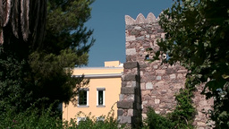 Greece the Aegean Sea Kos 060 old ruin and a house in pastel color Footage