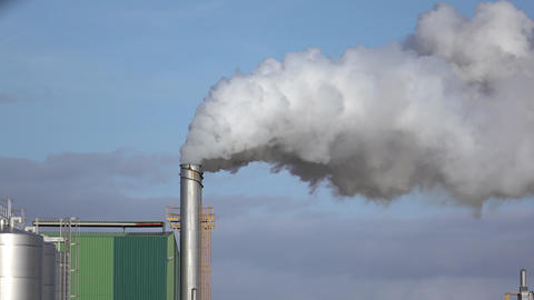 Steaming Pipe on Blue Sky Background Footage
