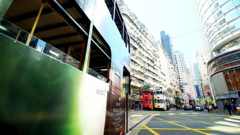Hong Kong city street view with moving transport. Original audio Footage