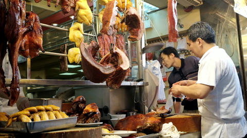 People shopping meat on the traditional asian street market. Hong Kong Footage