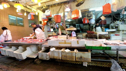 People shopping seafood on the traditional asian street market. Hong Kong Footage