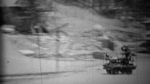 1934: Man riding railroad tracks on fast motorized velocipede handcar Footage