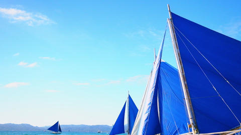 Sailing boats floating at sunny day in ocean waves. Boracay island, Philippines Footage