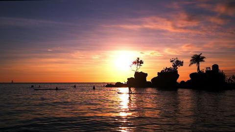 People on vacation, enjoying the amazing sunset at tropics. Boracay. Philippines Footage