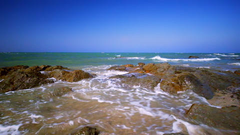 Amazing sunny day at tropical ocean beach. Waves breaking on the rocks. Myanmar Footage