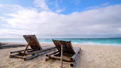 Tropical beach landscape with chairs for relaxation. Boracay, Philippines Footage