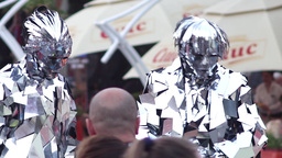 Actors dressed in a suit of mirrors was walking on the street during a festival  Footage