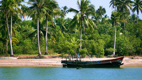 Tropical ocean beach with traditional fisherman boat near village. Myanmar Footage