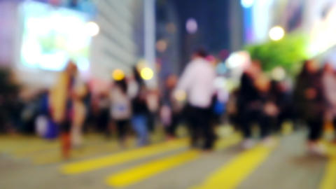 Abstract blurred video of crowded night city. Hong Kong night life Footage