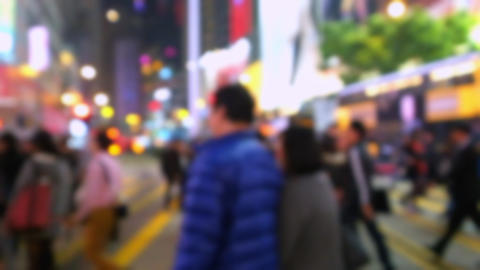 Blurred slow motion video of people moving in crowded city street. Hong Kong Footage
