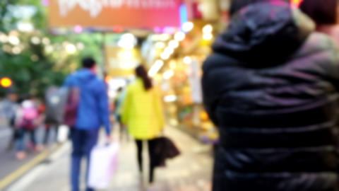 Live camera motion video of people walking at crowded modern city. Hong Kong Footage