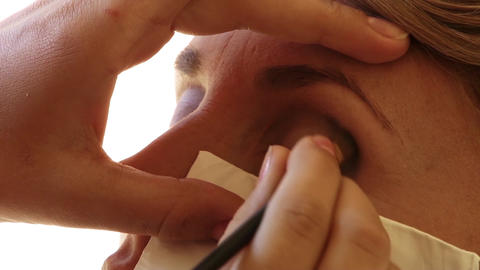 Beautician make powder his client orbits to a makeup 51 Footage