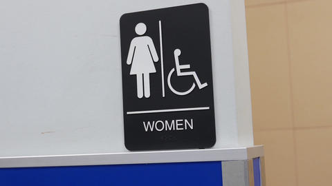 Motion of women and disable washroom logo on wall Footage