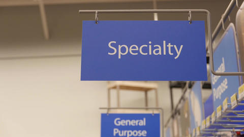 Motion of specialty sign on new smart bulb section inside Walmart store Live Action